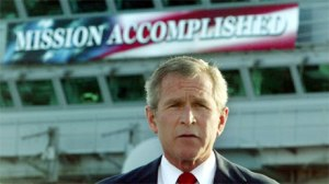 "President George W. Bush, under the ""Mission Accomplished"" banner during the ceremony of breaking ground for the Presidential Library. (Image source: thepoliticalzealot.com)"