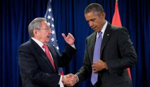 In their face-to-face meeting, Raul Castro expressed optimism for greater co-operation between two countries, then discreetly pointed out to Mr. Obama that his fly is undone. Image credit: Washington Times