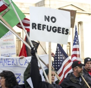 American protesters are greeting the Syrians with some hate and bigotry, so that the refugees from the civil wars and sectarian violence would feel right at home.