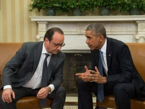 """""""So, Francois, I know we were talking about terrorism and this is off-topic, but check out how big my hands are compared to Trump's!"""" Image source: USAToday"""